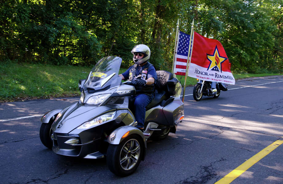 Ed Parshall, a Patriot Guard Rider of Waterbury, flys the Honor and Remember Flag on his bike as he travels on the Merritt Parkway in Stamford during the fourth annual Thunder on the Sound Motorcycle Ride and BBQ benefiting the Brian Bill Memorial Fund on Sunday, Sept. 23, 2012. Bikers assembled in the park and ride lot at Exit 35 off the Merritt Parkway. Photo: Amy Mortensen / Connecticut Post Freelance