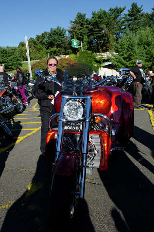 Debbie Vetti, of Stamford, stands next to her bike during the fourth annual Thunder on the Sound Motorcycle Ride and BBQ benefiting the Brian Bill Memorial Fund on Sunday, Sept. 23, 2012 in Stamford. Bikers assembled in the park and ride lot at Exit 35 off the Merritt Parkway. Photo: Amy Mortensen / Connecticut Post Freelance