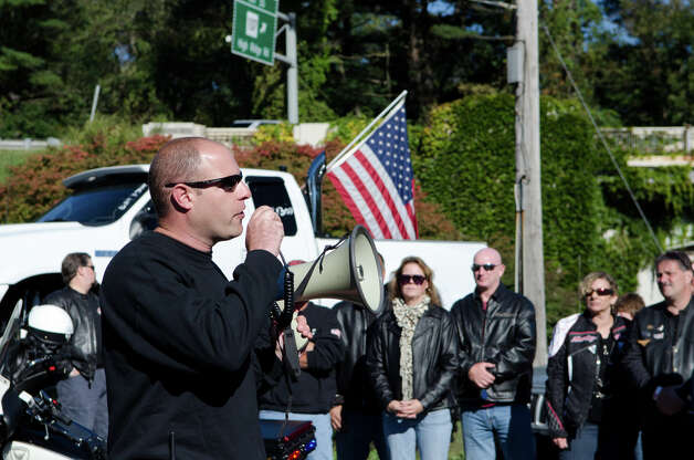 Patricks Sasser, event coordinator, speaks to bikers during the fourth annual Thunder on the Sound Motorcycle Ride and BBQ benefiting the Brian Bill Memorial Fund on Sunday, Sept. 23, 2012 in Stamford. Bikers assembled in the park and ride lot at Exit 35 off the Merritt Parkway. Photo: Amy Mortensen / Connecticut Post Freelance