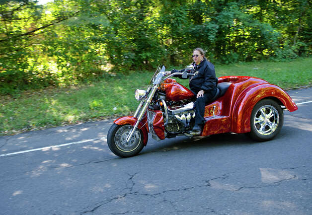 Debbie Vetti, of Stamford, cruises during the fourth annual Thunder on the Sound Motorcycle Ride and BBQ benefiting the Brian Bill Memorial Fund on Sunday, Sept. 23, 2012 in Stamford. Bikers assembled in the park and ride lot at Exit 35 off the Merritt Parkway. Photo: Amy Mortensen / Connecticut Post Freelance
