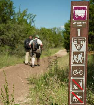 Hikers walk on the Joe Johnston trail route, Sunday, Sept. 23, 2012, at the Government Canyon State Natural Area in San Antonio. Photo: Darren Abate, Darren Abate/For The Express-New