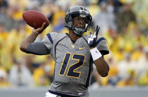 Geno Smith, West Virginia, 30-43-0, 338 yards, 3 TDs (Justin K. Aller / Getty Images)