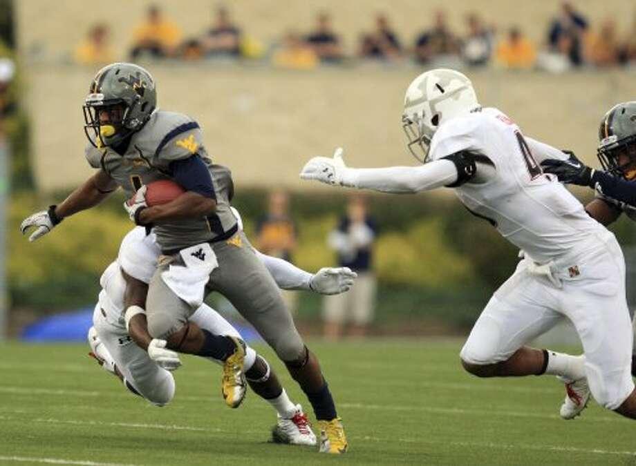 Tavon Austin, West Virginia, 13 catches, 179 yards, 3 TDs(Christopher Jackson / Associated Press)
