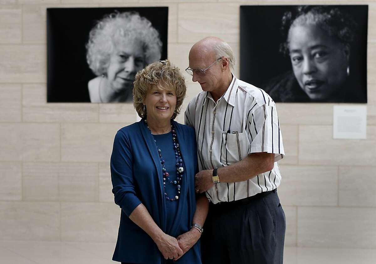 Dr. Christopher Benz (right) and his wife Connie, who is a breast cancer survivor, stand in the lobby of the Buck Institute in Novato, Calif. in front of photographs celebrating the aging of women. Dr. Christopher Benz, a UCSF oncologist and co-principal investigator of the UC Santa Cruz-Buck Institute Genome Data Analysis Center was a key researcher in an important genomic study of breast cancer.