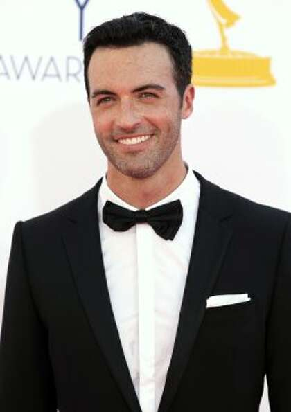 Reid Scott arrives at the 64th Primetime Emmy Awards at the Nokia Theatre on Sunday, Sept. 23, 2012,