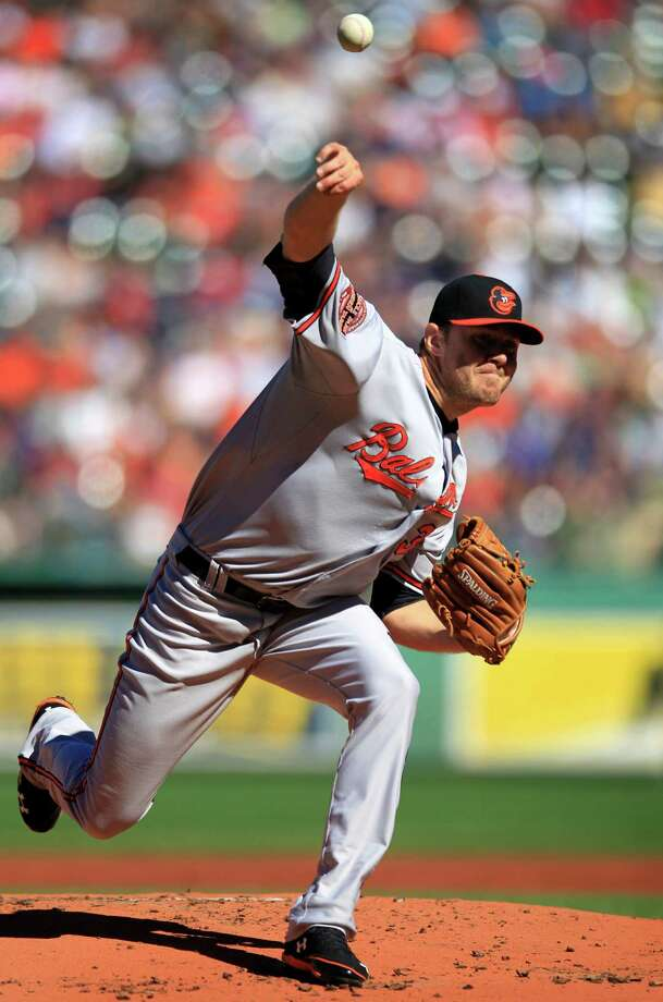 Baltimore Orioles starting pitcher Chris Tillman delivers a pitch against the Boston Red Sox in the first inning of a baseball game at Fenway Park, in Boston, Sunday, Sept. 23, 2012. (AP Photo/Steven Senne) Photo: Steven Senne