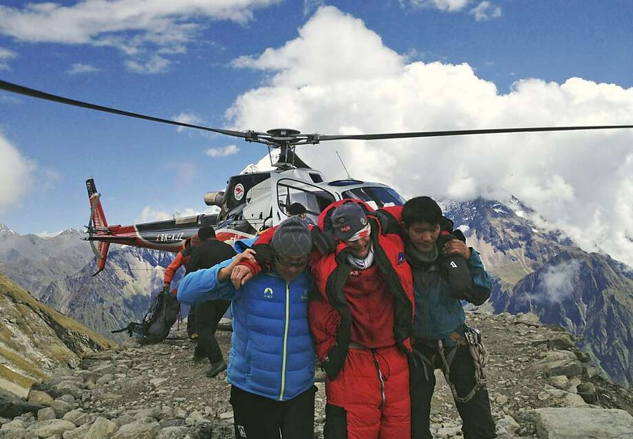 An injured victim is rescued after an avalanche on a Himalayan peak in Nepal killed nine climbers. Photo: Associated Press