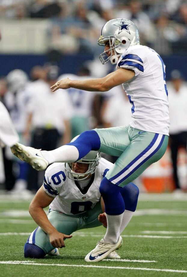 Dallas Cowboys kicker Dan Bailey (5) kicks a field goal with teammate Dallas Cowboys punter Chris Jones (6) during the second half of an NFL football game, Sunday, Sept. 23, 2012 in Arlington, Texas. (AP Photo/LM Otero) Photo: LM Otero, Associated Press / AP
