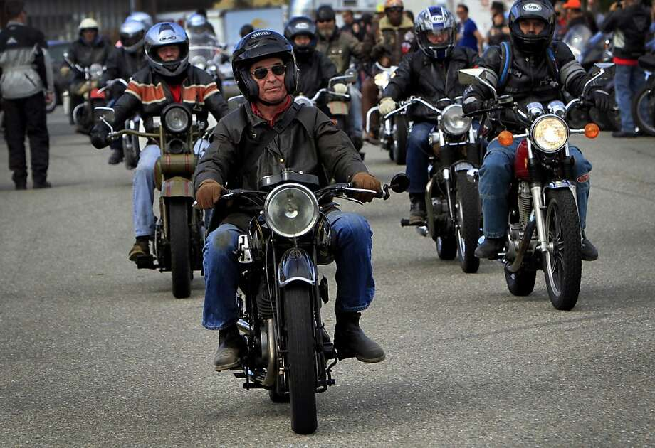 Racers in the third-annual cross-country Cannonball Endurance Run pull in to the finish line celebration at Dudley Perkins Harley Davidson in South San Francisco, Calif., Sunday, September 23, 2012.  Racers drive motorcycles built before 1930 from New York to California. Photo: Sarah Rice, Special To The Chronicle