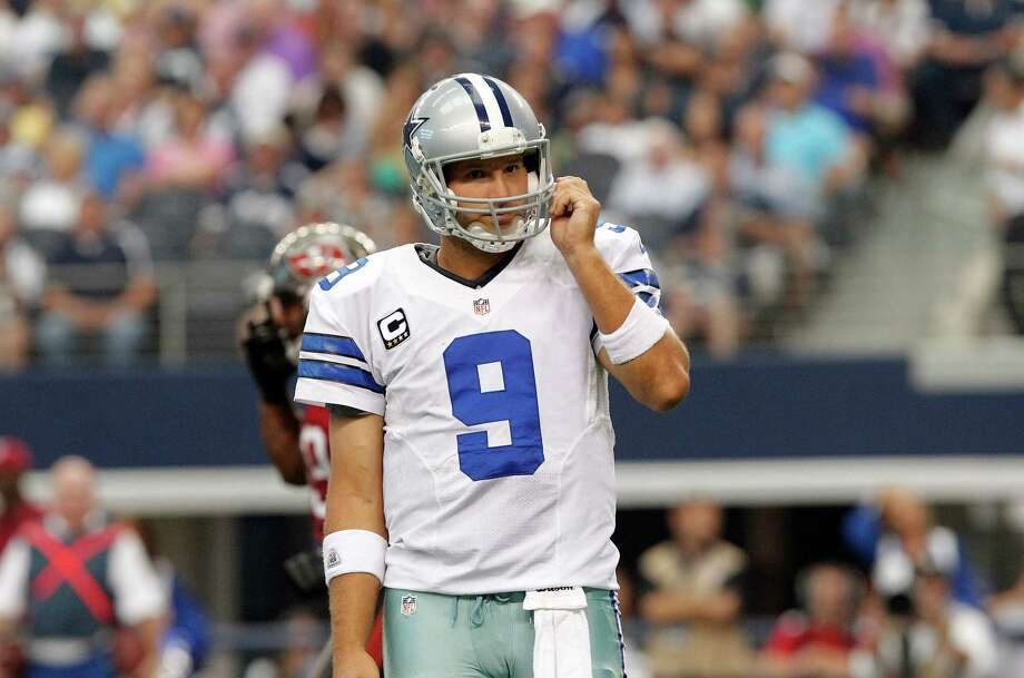 Dallas Cowboys quarterback Tony Romo (9) looks to the sideline during the second half of an NFL football game against the Tampa Bay Buccaneers , Sunday, Sept. 23, 2012 in Arlington, Texas. (AP Photo/Tim Sharp) Photo: Tim Sharp, Associated Press / FR62992 AP