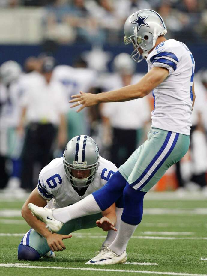 Dallas Cowboys punter Chris Jones (6) holds the ball for kicker Dan Bailey (5)during the second half of an NFL football game against the Tampa Bay Buccaneers, Sunday, Sept. 23, 2012 in Arlington, Texas. (AP Photo/LM Otero) Photo: LM Otero, Associated Press / AP