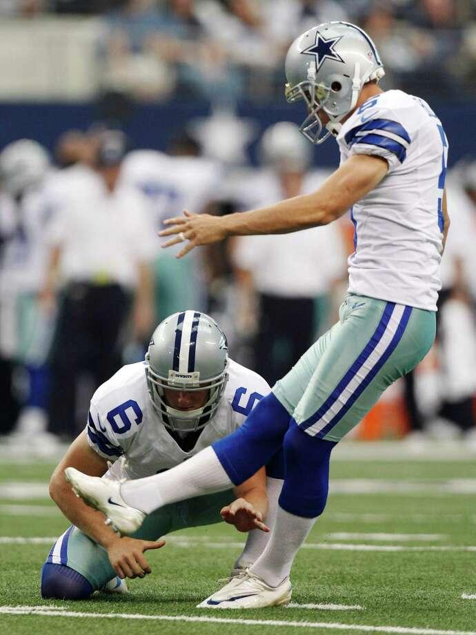 6bd01c572 Cowboys punter Chris Jones (6) holds the ball for kicker Dan Bailey (5