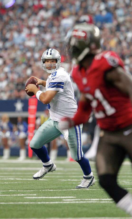 Dallas Cowboys quarterback Tony Romo (9) looks to pass against the Tampa Bay Buccaneers during the second half of an NFL football game, Sunday, Sept. 23, 2012 in Arlington, Texas. (AP Photo/Tim Sharp) Photo: Tim Sharp, Associated Press / FR62992 AP