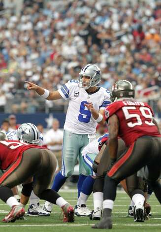 Dallas Cowboys quarterback Tony Romo (9) lines up players against the Tampa Bay Buccaneers during the second half of an NFL football game, Sunday, Sept. 23, 2012 in Arlington, Texas. (AP Photo/Tim Sharp) Photo: Tim Sharp, Associated Press / FR62992 AP
