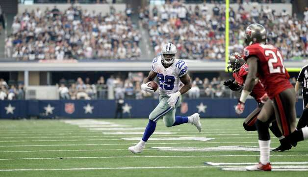 Dallas Cowboys running back DeMarco Murray (29) finds open field during the second half of an NFL football game against the Tampa Bay Buccaneers, Sunday, Sept. 23, 2012 in Arlington, Texas. (AP Photo/Tim Sharp) Photo: Tim Sharp, Associated Press / FR62992 AP