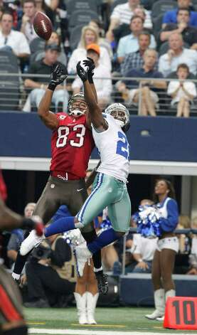 Tampa Bay Buccaneers wide receiver Vincent Jackson (83) and Dallas Cowboys cornerback Mike Jenkins (21) during the second half of an NFL football game, Sunday, Sept. 23, 2012 in Arlington, Texas. (AP Photo/Tim Sharp) Photo: Tim Sharp, Associated Press / FR62992 AP