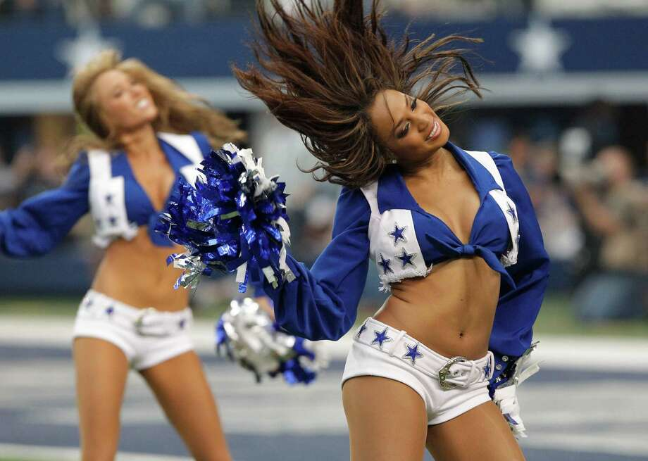 Dallas Cowboys cheerleaders perform during the second half of an NFL football game between Dallas Cowboys and the Tampa Bay Buccaneers, Sunday, Sept. 23, 2012 in Arlington, Texas. (AP Photo/Tim Sharp) Photo: Tim Sharp, Associated Press / FR62992 AP