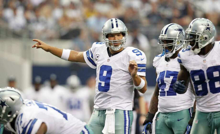 Dallas Cowboys quarterback Tony Romo (9) instructs his teammates during the second half of an NFL football game against the Tampa Bay Buccaneers , Sunday, Sept. 23, 2012 in Arlington, Texas. (AP Photo/Tim Sharp) Photo: Tim Sharp, Associated Press / FR62992 AP