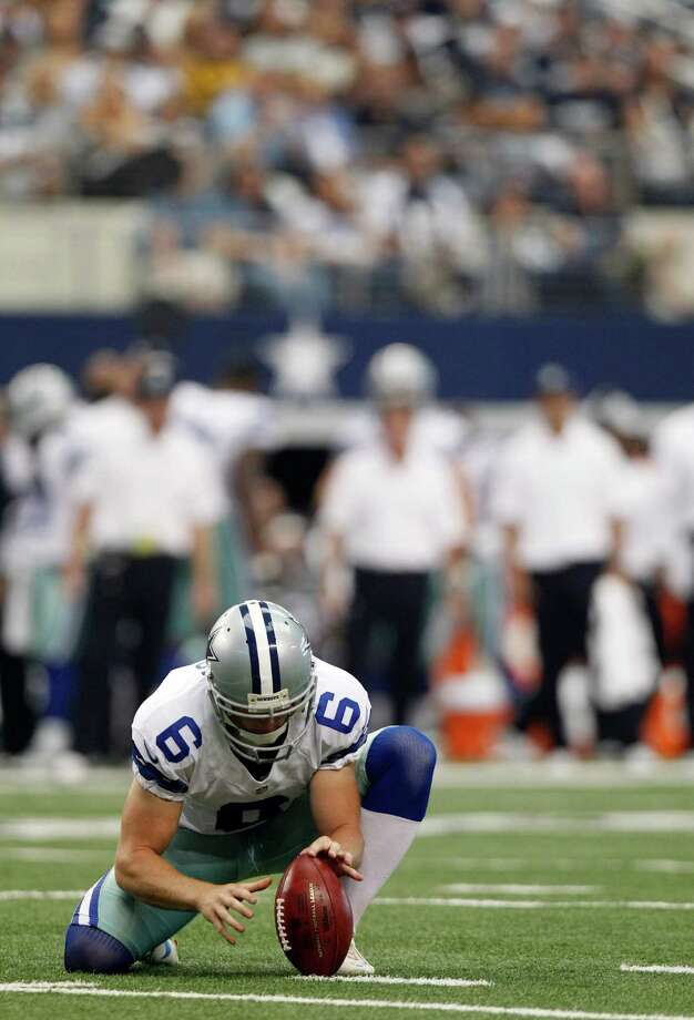 Dallas Cowboys Chris Jones (6) holds the field goal kick during the second half of an NFL football game against the Tampa Bay Buccaneers, Sunday, Sept. 23, 2012 in Arlington, Texas. (AP Photo/LM Otero) Photo: LM Otero, Associated Press / AP