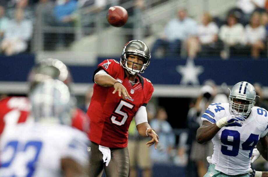 Tampa Bay Buccaneers quarterback Josh Freeman (5) passes the ball against the Dallas Cowboys during the second half of an NFL football game, Sunday, Sept. 23, 2012 in Arlington, Texas. (AP Photo/LM Otero) Photo: LM Otero, Associated Press / AP