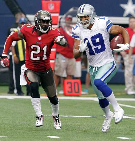 Dallas Cowboys wide receiver Miles Austin (19) gets past Tampa Bay Buccaneers defensive back Eric Wright (21) during the second half of an NFL football game, Sunday, Sept. 23, 2012 in Arlington, Texas. (AP Photo/Tim Sharp) Photo: Tim Sharp, Associated Press / FR62992 AP