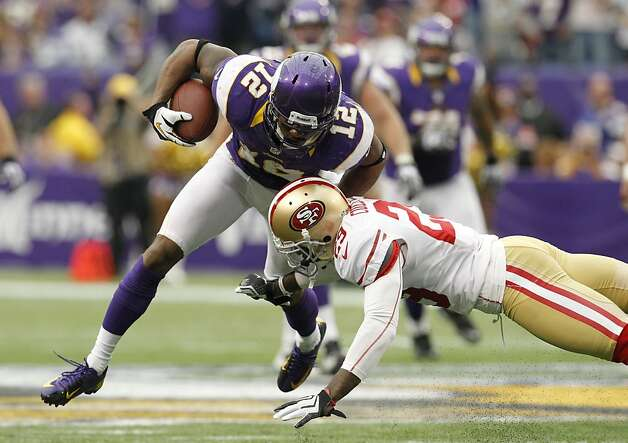 Minnesota Vikings wide receiver Percy Harvin (12) tries to break a tackle by San Francisco 49ers defensive back Chris Culliver, right, after making a reception during the second half of an NFL football game Sunday, Sept. 23, 2012, in Minneapolis. (AP Photo/Genevieve Ross) Photo: Genevieve Ross, Associated Press
