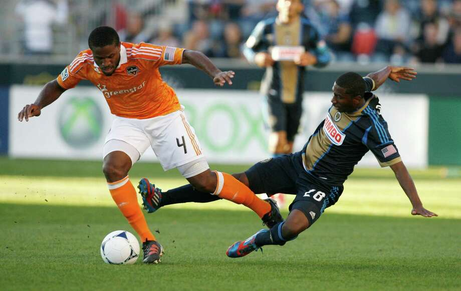 CHESTER, PA - SEPTEMBER 23: Jermaine Taylor #4 of the Houston Dynamo gets away from a tackle attempt by Raymon Gaddis #28 of the Philadelphia Union at PPL Park on September 23, 2012 in Chester, Pennsylvania. Photo: Chris Gardner, Getty Images / 2012 Getty Images