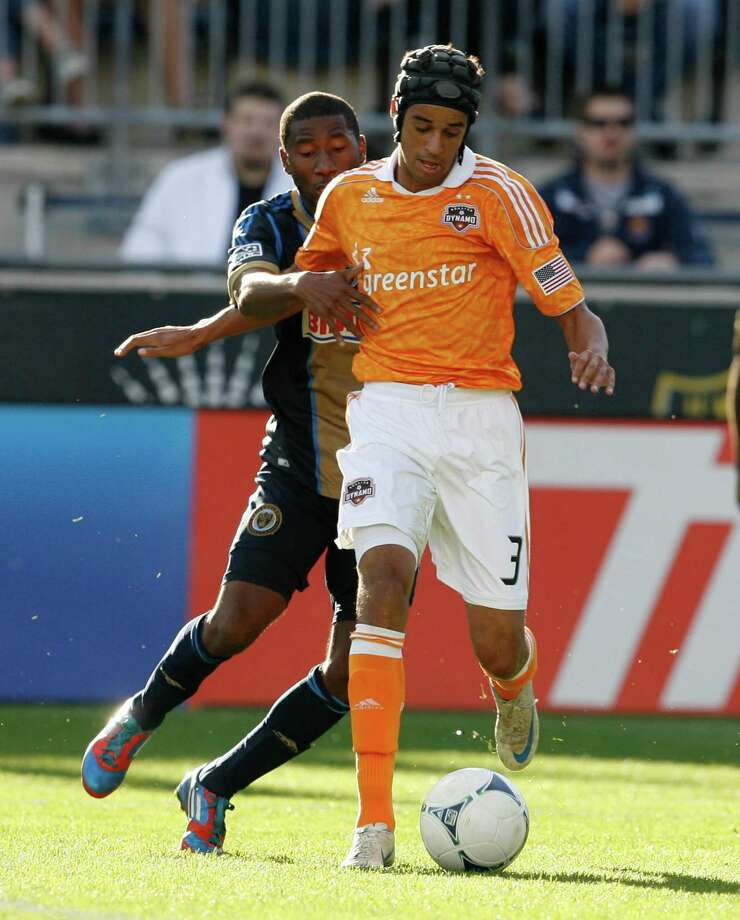 CHESTER, PA - SEPTEMBER 23: Calen Carr #3 of the Houston Dynamo is held by Ramon Gaddis #28 of the Philadelphia Union at PPL Park on September 23, 2012 in Chester, Pennsylvania. Photo: Chris Gardner, Getty Images / 2012 Getty Images