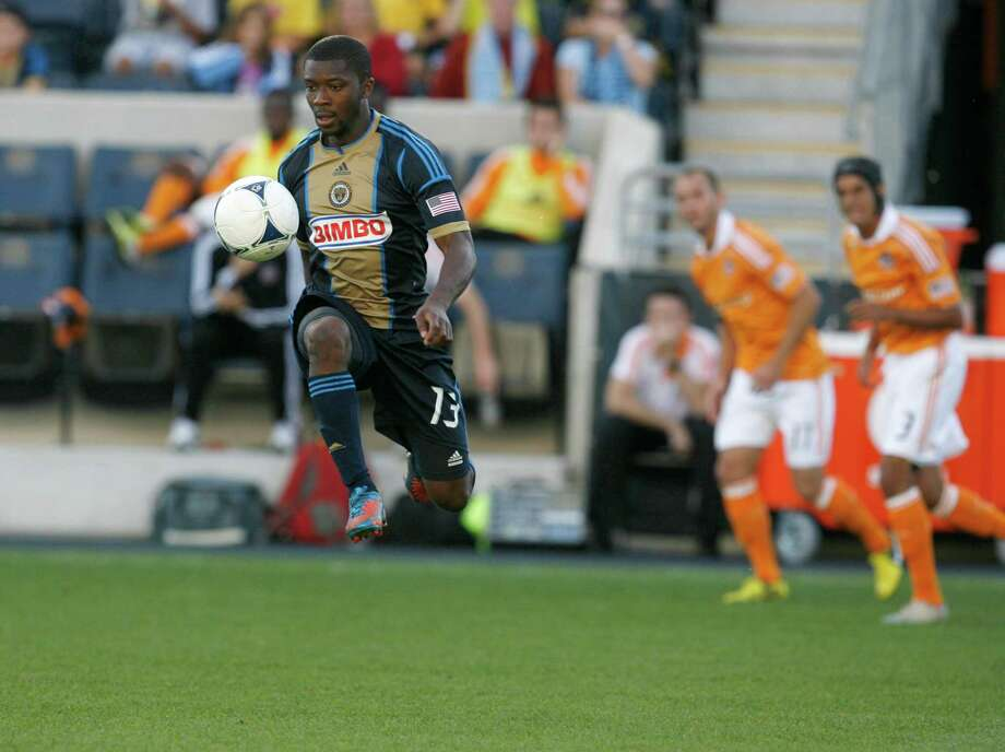 CHESTER, PA - SEPTEMBER 23: Michael Lahoud #13 of the Philadelphia Union pushes the ball up field against the Houston Dynamo at PPL Park on September 23, 2012 in Chester, Pennsylvania. Photo: Chris Gardner, Getty Images / 2012 Getty Images