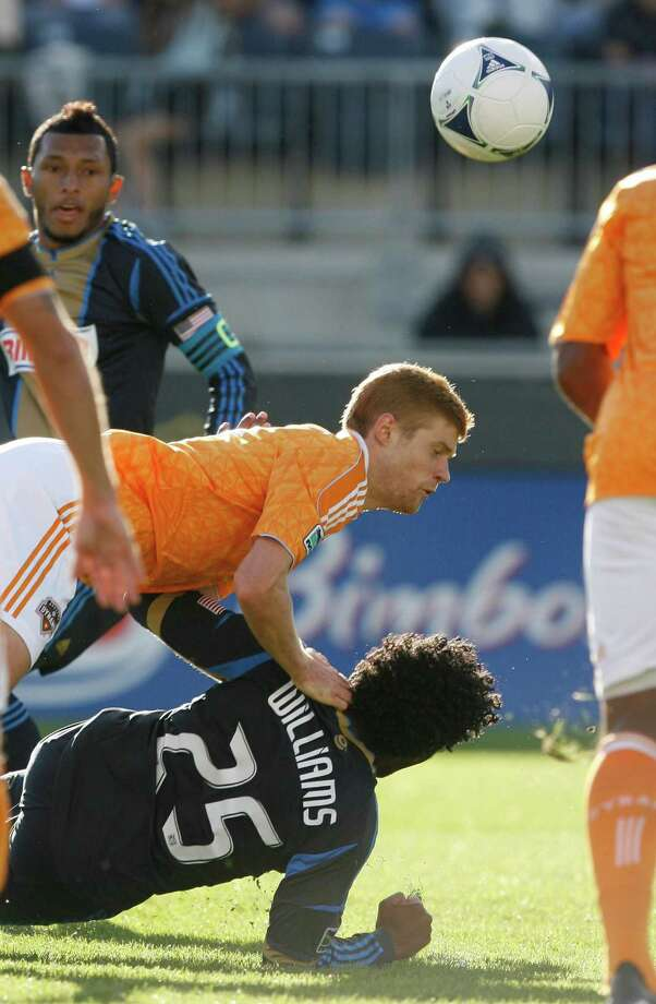 CHESTER, PA - SEPTEMBER 23: Andre Hainault #3 of the Houston Dynamo takes down Sheanon Williams #25 of the Philadelphia Union at PPL Park on September 23, 2012 in Chester, Pennsylvania. A penalty kick resulted in the call. Photo: Chris Gardner, Getty Images / 2012 Getty Images
