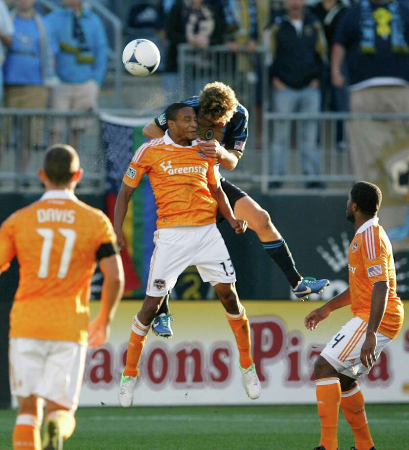 CHESTER, PA - SEPTEMBER 23: Ricardo Clark #13 of the Houston Dynamo wins a header as he is held by Chris Albright #3 of the Philadelphia Union at PPL Park on September 23, 2012 in Chester, Pennsylvania. Photo: Chris Gardner, Getty Images / 2012 Getty Images