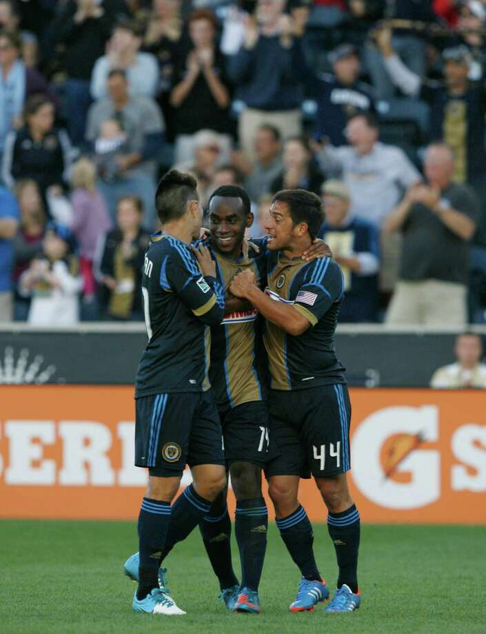 CHESTER, PA - SEPTEMBER 23: Amobi Okugo #14 of the Philadelphia Union is congratulated by teammates Michael Farfan #21 and Danny Cruz #44 after scoring a goal against the Houston Dynamo at PPL Park on September 23, 2012 in Chester, Pennsylvania. Photo: Chris Gardner, Getty Images / 2012 Getty Images