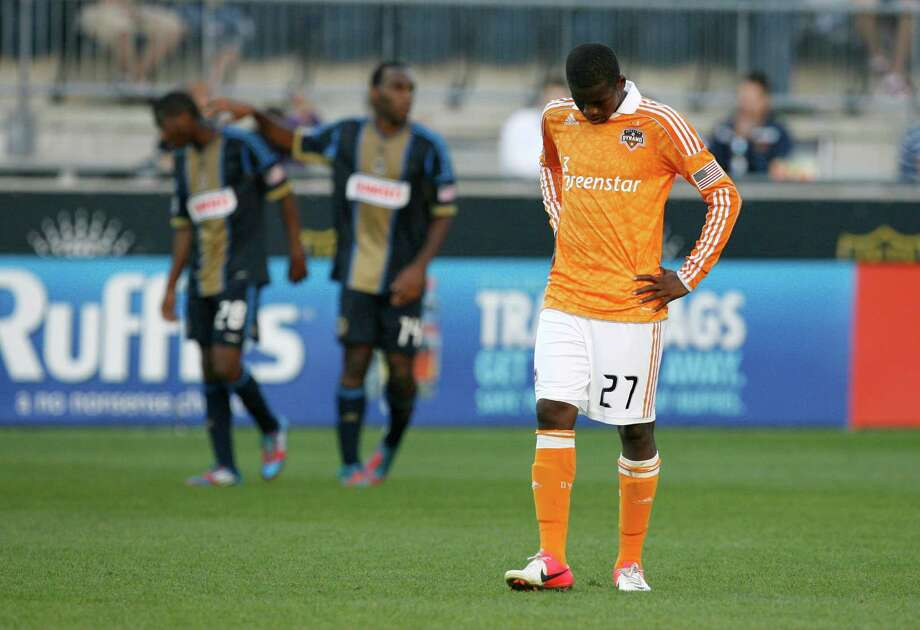 CHESTER, PA - SEPTEMBER 23: Boniek Garcia #27 of the Houston Dynamo reacts as he walks off the field as Raymon Gaddis #28 and Omobi Okugo #14 of the Philadelphia Union congratulate each other after their win at PPL Park on September 23, 2012 in Chester, Pennsylvania. The Union won 3-1. Photo: Chris Gardner, Getty Images / 2012 Getty Images