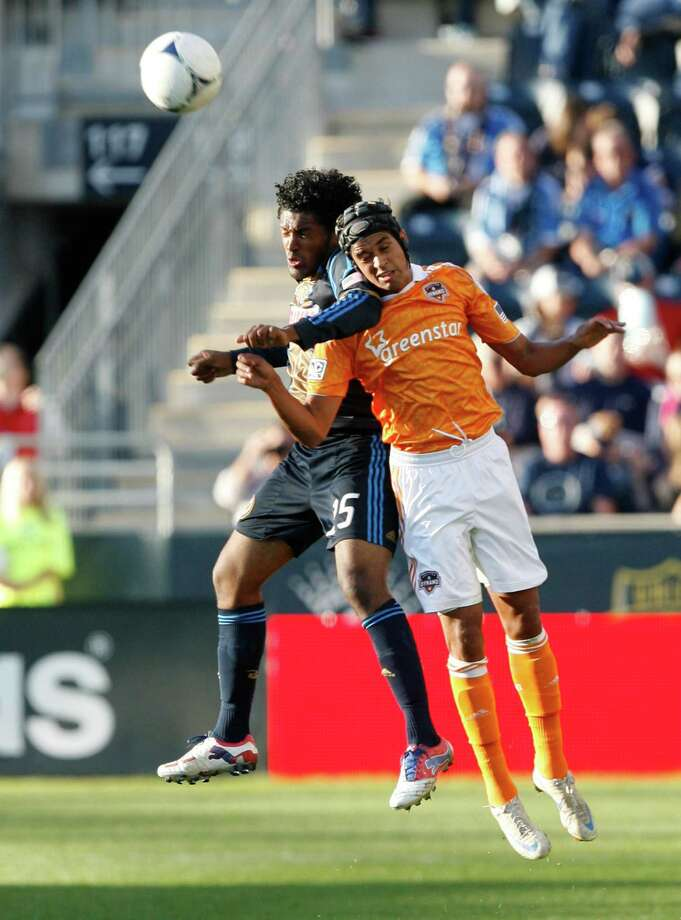 CHESTER, PA - SEPTEMBER 23: Calen Carr #3 of the Houston Dynamo challenges Sheanon Williams #25 of the Philadelphia Union at PPL Park on September 23, 2012 in Chester, Pennsylvania. Photo: Chris Gardner, Getty Images / 2012 Getty Images