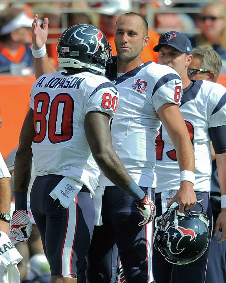 Houston Texans quarterback Matt Schaub (8) congratulates Houston Texans wide receiver Andre Johnson (80) after Johnson caught a pass for a touchdown in the first quarter of an NFL football game against the Denver Broncos Sunday, Sept. 23, 2012, in Denver. (AP Photo/Jack Dempsey) Photo: Jack Dempsey, Associated Press / FR42408 AP