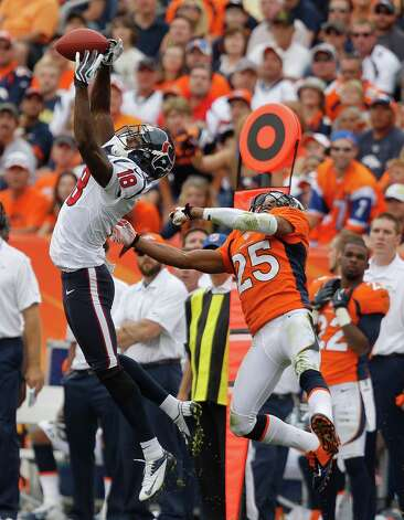 Houston Texans wide receiver Lestar Jean (18) leaps to catch a pass against Denver Broncos strong safety Chris Harris (25) in the third quarter of an NFL football game Sunday, Sept. 23, 2012, in Denver. (AP Photo/David Zalubowski) Photo: David Zalubowski, Associated Press / AP