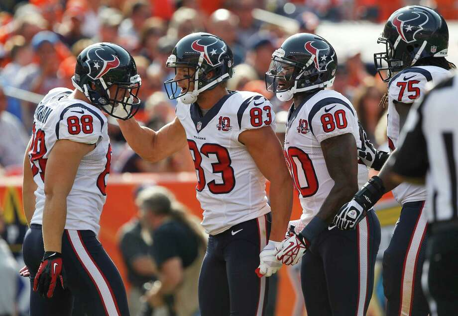 Houston Texans wide receiver Kevin Walter (83) celebrates with tight end Garrett Graham (88), wide receiver Andre Johnson (80) and tackle Derek Newton (75) after catching a pass for a touchdown in the second quarter of an NFL football game against the Denver Broncos, Sunday, Sept. 23, 2012, in Denver. (AP Photo/David Zalubowski) Photo: David Zalubowski, Associated Press / AP