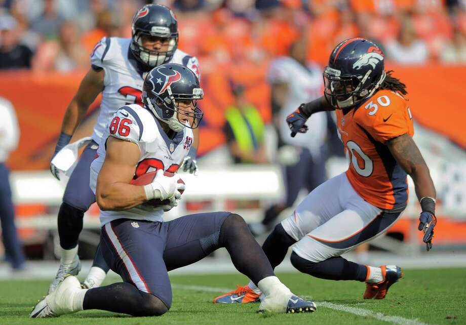 Houston Texans fullback James Casey (86) recovers an onside kick as Denver Broncos free safety David Bruton (30) defends in the third quarter of an NFL football game Sunday, Sept. 23, 2012, in Denver. (AP Photo/Jack Dempsey) Photo: Jack Dempsey, Associated Press / FR42408 AP