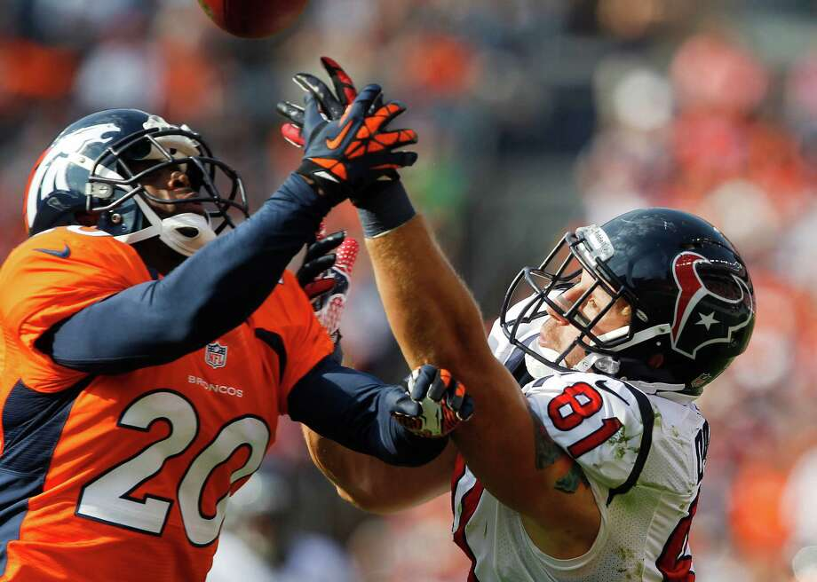 Denver Broncos strong safety Mike Adams (20) breaks up a pass intended for Houston Texans tight end Owen Daniels (81) in the third quarter of an NFL football game Sunday, Sept. 23, 2012, in Denver. (AP Photo/David Zalubowski) Photo: David Zalubowski, Associated Press / AP