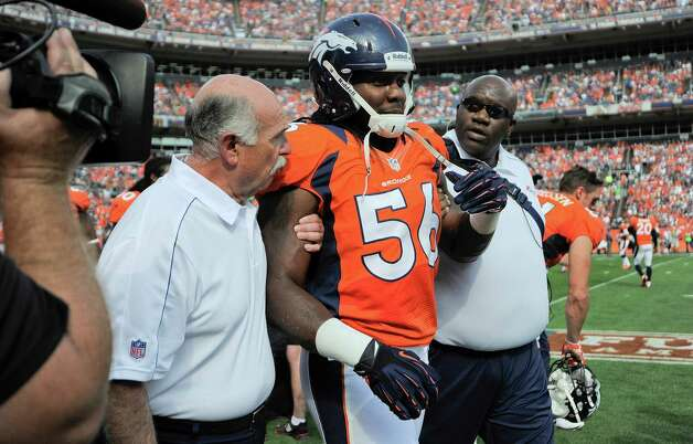 Denver Broncos linebacker Nate Irving (56) is helped off the field after an injury during the second quarter of an NFL football game against the Houston Texans, Sunday, Sept. 23, 2012, in Denver. (AP Photo/Jack Dempsey) Photo: Jack Dempsey, Associated Press / FR42408 AP