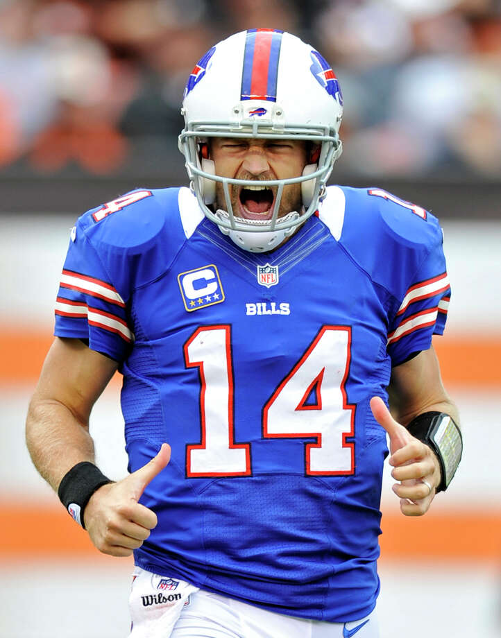 Buffalo Bills quarterback Ryan Fitzpatrick reacts after throwing a 9-yard touchdown pass to wide receiver Steve Johnson in the fourth quarter of an NFL football game against the Cleveland Browns, Sunday, Sept. 23, 2012, in Cleveland. (AP Photo/David Richard) Photo: David Richard