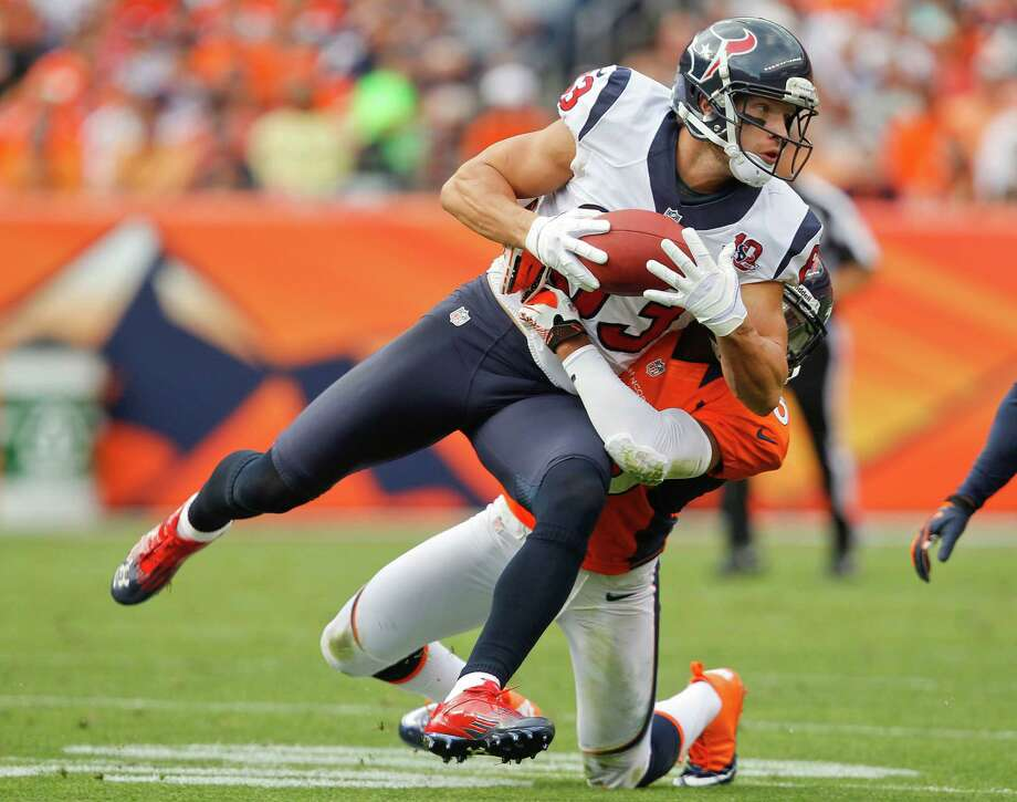 Houston Texans wide receiver Kevin Walter (83) brings down a pass as he is hit by Denver Broncos strong safety Chris Harris (25) in the fourth quarter of an NFL football game Sunday, Sept. 23, 2012, in Denver. (AP Photo/David Zalubowski) Photo: David Zalubowski, Associated Press / AP