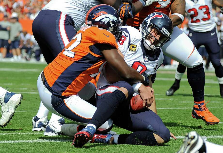 Houston Texans quarterback Matt Schaub (8) is sacked in the end zone for a safety by Denver Broncos defensive end Elvis Dumervil (92) during the first quarter of an NFL football game Sunday, Sept. 23, 2012, in Denver. (AP Photo/Jack Dempsey) Photo: Jack Dempsey, Associated Press / FR42408