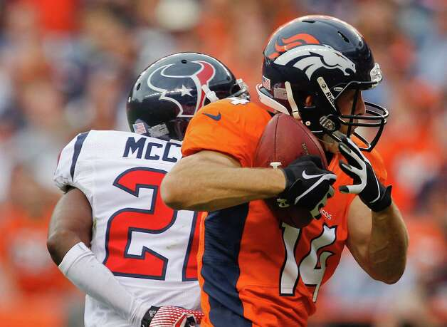 Denver Broncos wide receiver Brandon Stokley (14) catches a pass for a touchdown against Houston Texans defensive back Brice McCain (21) in the fourth quarter of an NFL football game Sunday, Sept. 23, 2012, in Denver. (AP Photo/David Zalubowski) Photo: David Zalubowski, Associated Press / AP