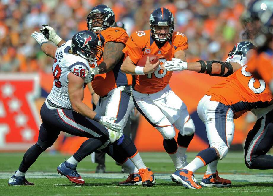 Denver Broncos quarterback Peyton Manning (18) runs the ball against Houston Texans outside linebacker Brooks Reed (58) in the second quarter of an NFL football game Sunday, Sept. 23, 2012, in Denver. (AP Photo/Jack Dempsey) Photo: Jack Dempsey, Associated Press / FR42408 AP