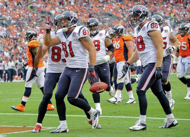 Houston Texans tight end Owen Daniels (81) celebrates with wide receiver Kevin Walter (83), outside linebacker Connor Barwin (98) and tackle Ryan Harris (68) after scoring a touchdown in the third quarter of an NFL football game Sunday, Sept. 23, 2012, in Denver. (AP Photo/Jack Dempsey) Photo: Jack Dempsey, Associated Press / FR42408