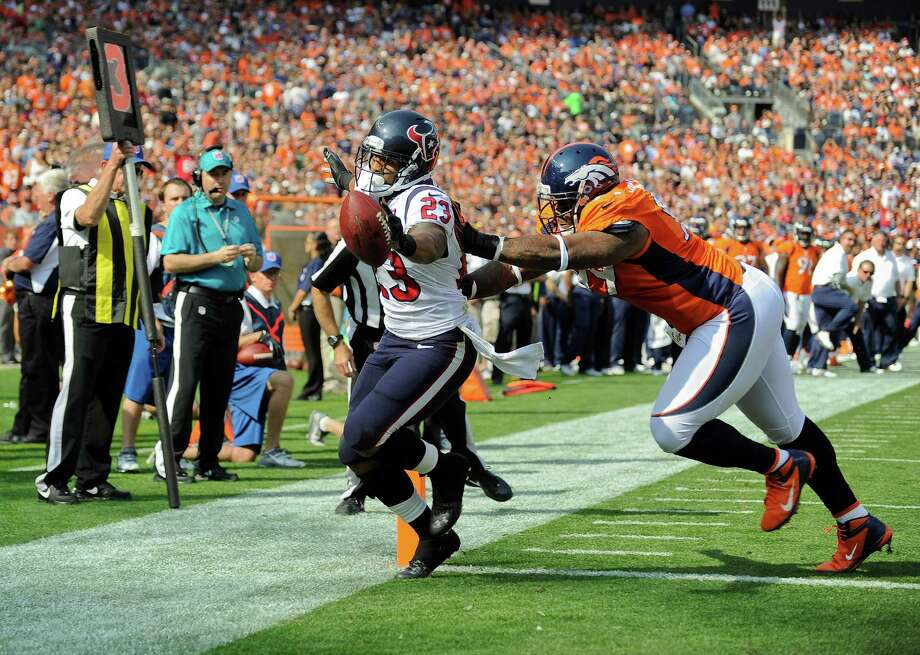 Houston Texans running back Arian Foster (23) scores a touchdown against Denver Broncos defensive tackle Kevin Vickerson (99) in the first quarter of an NFL football game Sunday, Sept. 23, 2012, in Denver. (AP Photo/Jack Dempsey) Photo: Jack Dempsey, Associated Press / FR42408