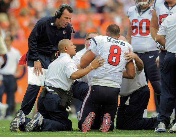 Houston Texans quarterback Matt Schaub (8) is checked by coach Gary Kubiak and trainers after taking a hit in the third quarter of an NFL football game against the Denver Broncos Sunday, Sept. 23, 2012, in Denver. (AP Photo/Jack Dempsey) Photo: Jack Dempsey, Associated Press / FR42408 AP