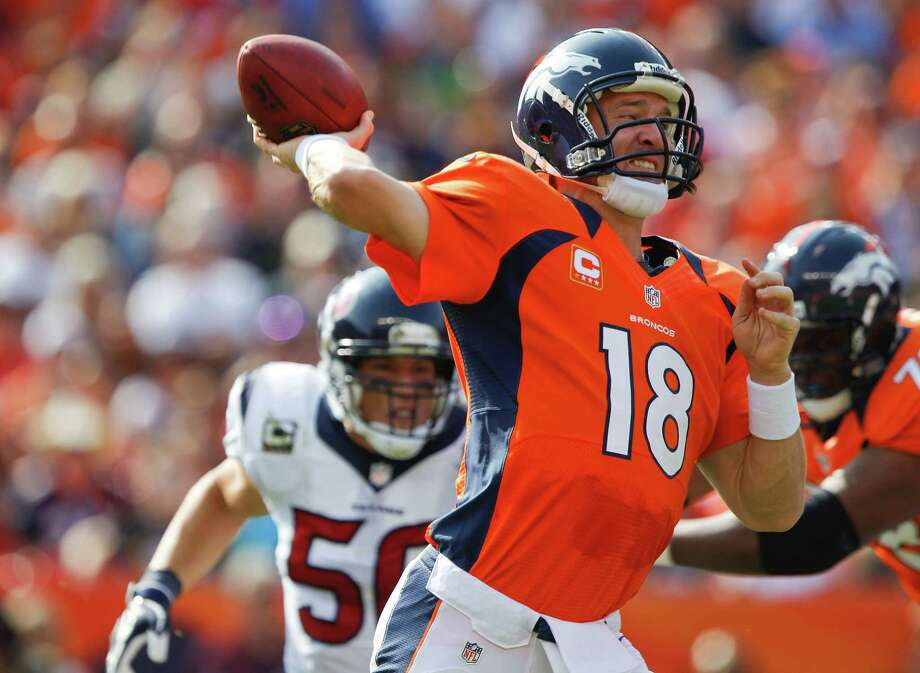 Denver Broncos quarterback Peyton Manning (18) throws against the Houston Texans in the second quarter of an NFL football game Sunday, Sept. 23, 2012, in Denver. (AP Photo/David Zalubowski) Photo: David Zalubowski, Associated Press / AP