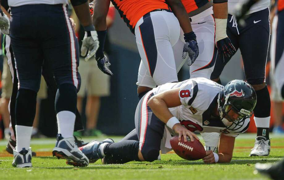 Houston Texans quarterback Matt Schaub (8) gets up off the ground after being sacked in the end zone for a safety by the Denver Broncos during the first quarter of an NFL football game Sunday, Sept. 23, 2012, in Denver. (AP Photo/David Zalubowski) Photo: David Zalubowski, Associated Press / AP